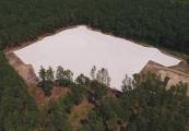 Pokaż powiększenie powyżej: Zabezpieczenie polany masowych mogił w Sobiborze, fot. Piotr Bartmiński