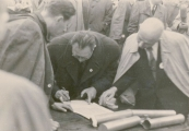 Show larger image above: Signing an erection act for the mound with ashes of the Majdanek victims, 1947