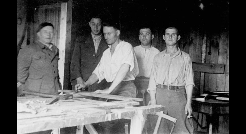 Zoom image: Museum employees in the carpenter's shop