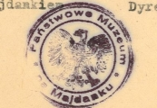 Show larger image above: Museum seal with the national emblem